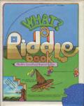 Jane Sarnoff,Reynold Ruffins: WHAT? A RIDDLE BOOK