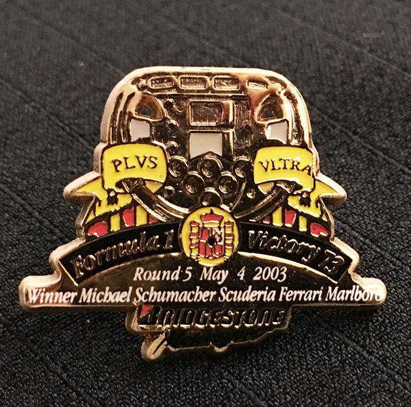 ブリヂストン 2003 F1 スペインGP 優勝記念ピンバッチ  73勝目  サイズ:縦2.3cm×横3cm