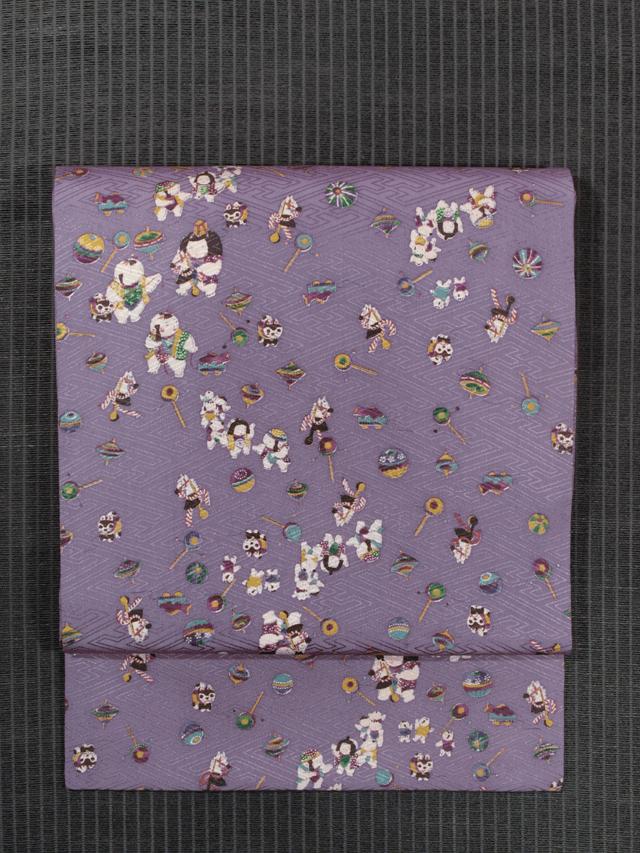 紗綾型の地紋に玩具と童子文様 型染め 名古屋帯