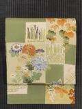 色紙に草花文様 型染めに手刺繍 名古屋帯