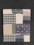 格子縞に幾何学文様 絣織り 名古屋帯