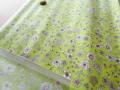 小花プリント つや消しラミネート(ヒワグリーン系) 約50cmカット