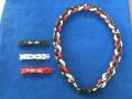 【ファイテン】ラクワネックX50 四つ編み ブラック2本×ホワイト1本×レッド1本 サイズ:約50cm アジャスター(約6cm)×3個付き
