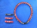【ファイテン】ラクワネックX50 四つ編み ブラック2本×レッド2本 サイズ:約50cm アジャスター(約6cm)×3個付き