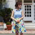 夏の日差しに映えるトロピカルフラワーウエストタックスカート  泉里香さんはホワイトを着用
