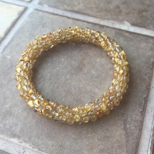 『金色の豊かさを身に着ける』  高品質ルチルクォーツのクロッシェ