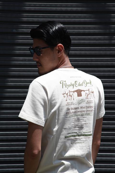 TROPHY CLOTHING/トロフィークロージング  「Oiled Duck Pocket Tee」  オーバーダイプリントティーシャツ
