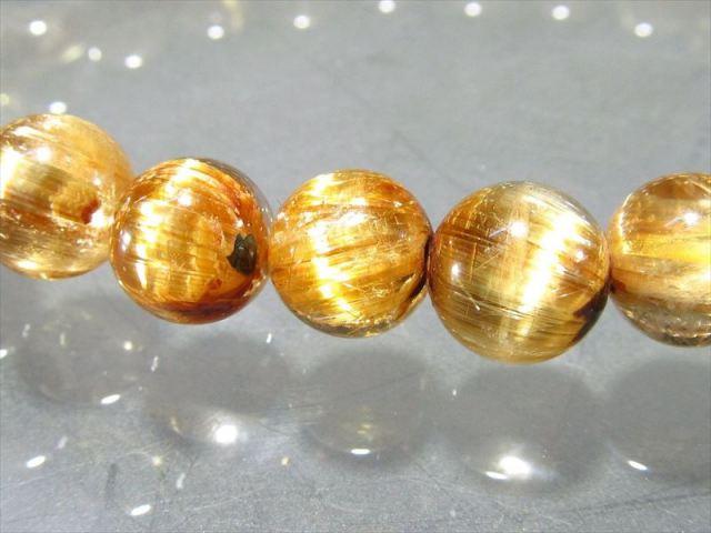 希少な母岩入り 母岩ヘマタイト付き 太陽タイチン ゴールドルチル ブレスレット 7mm-7.5mm×26珠 煌々と輝く板状タイチン入り 一点もの ブラジル産