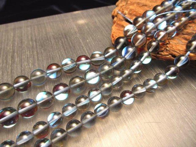 激安宣言 10mm珠 ブラック・レインボーグラスオーラ・ルナフラッシュ 一連 約40cm 人工石 geki