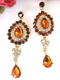 <英国ビンテージ>1960年代:オレンジ色のヨーロピアンガラス♪クリスタルも輝く揺れるチャームがきれいな光のピアス