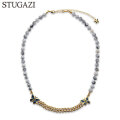 STUGAZI WHITE TURQUOISE BUTTERFLY NECKLACE スガジ ネックレス (2色展開)