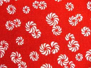 太陽の象徴 毛卍文 巻毛文 獅子舞の模様 レーヨンちりめん生地 赤色(0643-41)
