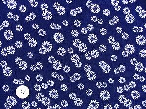 太陽の象徴 毛卍文 巻毛文 獅子舞の模様 レーヨンちりめん生地 紺色(0643-43)