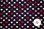 可愛いハートがいっぱい スケアー・プチハートプリント生地 ブラック地×ピンク