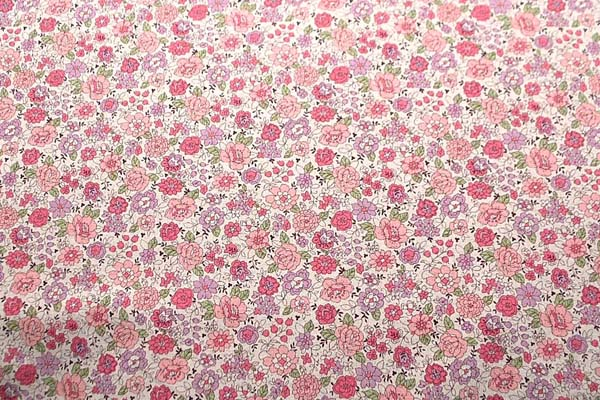 綿麻キャンバス YUWAのフラワープリント生地 生成り地にピンク・紫系