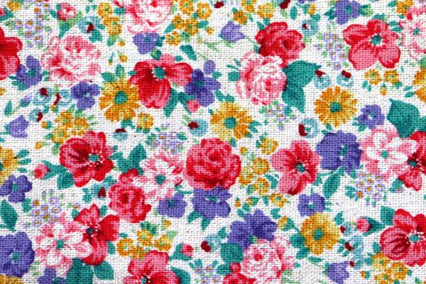 YUWAの綿麻キャンバス 小花プリント 生成地に明るい花