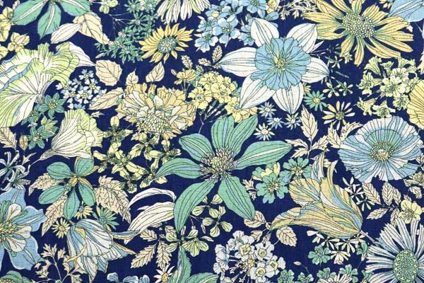 ルシアンの綿麻シャーティング メモアール・ア・パリ 紺地に黄色・緑系の花