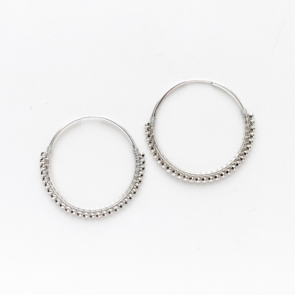 viv&ingrid/1.25'' sterling silver endless hoop wrapped with silver beads.