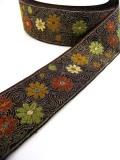 カラフルな花びらが飛び交うジュリアンフォール社のジャガード織リボン(4カラー)