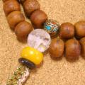 [数珠・ネックレス]鳳眼菩提樹54果 青龍彫刻水晶 黒瑪瑙 琥珀 チベット真鍮ビーズ 正絹紐房八本組み