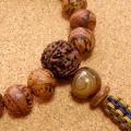 [数珠・念珠]龍眼菩提樹20珠 十二支守護本尊の梵児オニキス 金剛菩提樹 チベット瑪瑙 正絹紐房八本組み