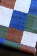 手織り九寸名古屋帯/多色市松絣文様
