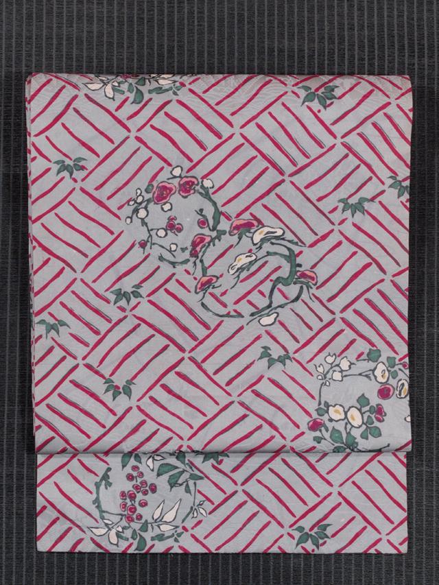 冊子の地紋に網代と花丸文様 型染め 名古屋帯
