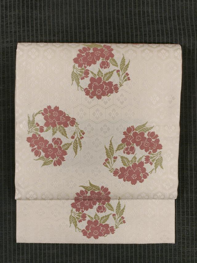 花亀甲に桜丸文様 西陣織り 額縁仕立て名古屋帯