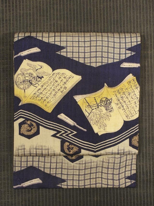 松皮菱に格子と冊子文様 型染め 紬 名古屋帯