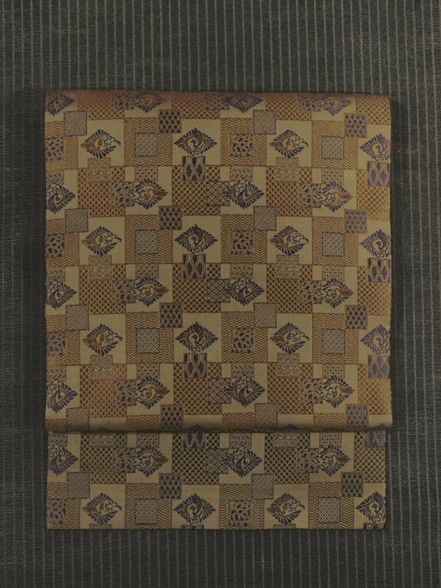 市松格子に幾何学文と鳳凰文様 緞子織り 名古屋帯