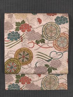 紗綾型の地紋に牡丹と源氏車文様 型染め 名古屋帯
