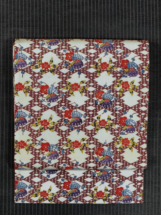 松皮菱に貝と花文様 紅型 名古屋帯