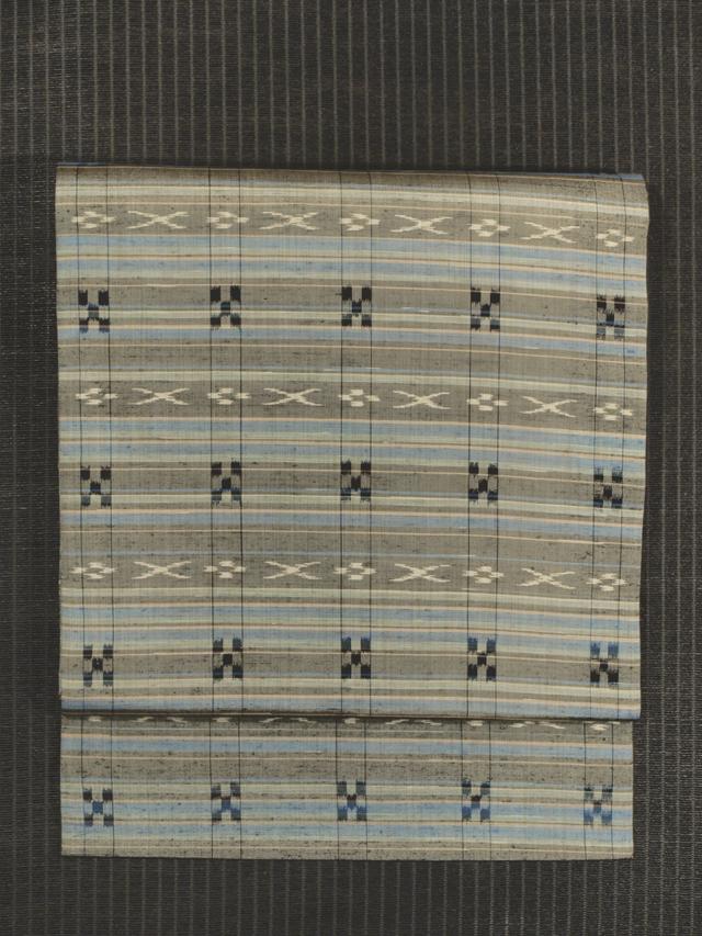縞に琉球文様 絣織り 名古屋帯