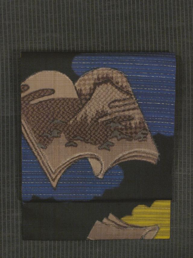雲取りに冊子文様 絣織り 名古屋帯