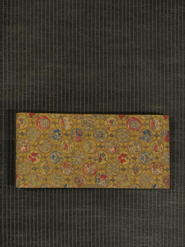 丸に吉祥文と草花文様 型染め 半巾帯
