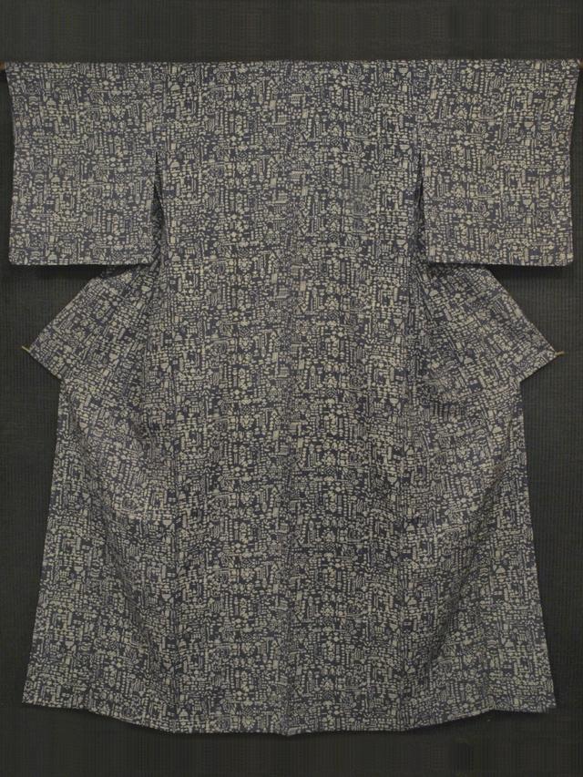 縦縞の地紋にコプト文様 型染め 小紋 単衣