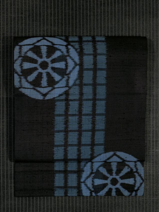 格子縞に源氏車文様 絣織り 名古屋帯