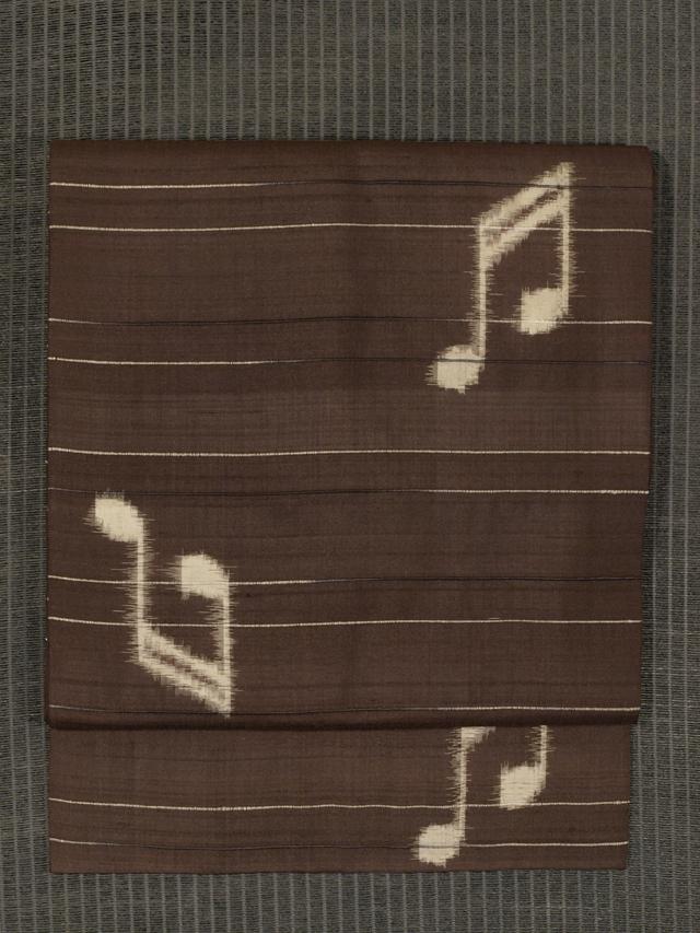 縞に音符文 絣織り 名古屋帯