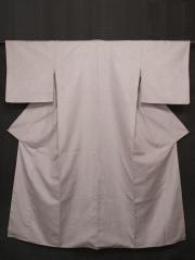 薄桜(うすざくら)地 幾何学文様の浮き織りに縦縞文様 紬 袷