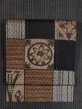 市松格子の絣織りに花文様の手描き染め 名古屋帯