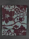 格子縞の織りに花文様の型染め 名古屋帯