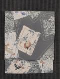 色紙に風物文様 型染め 名古屋帯