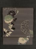 縞柄のふくれ織り地に雪輪と草花文様 型染め 名古屋帯