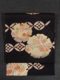 雪輪に四季の草花文様 型染め 名古屋帯