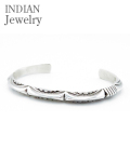 NAVAJO TRIANGLE STAMPED SILVER BANGLE