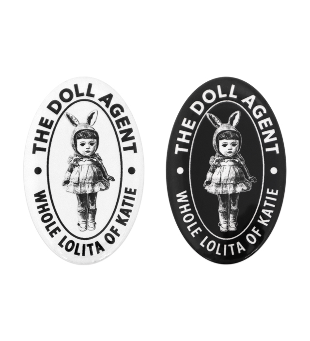 BADGE THE DOLL AGENT 70 oval