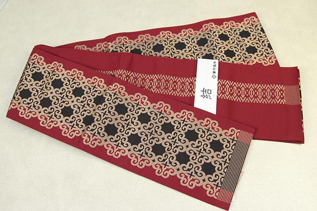 西村織物 結 博多織 正絹半幅帯 かがり仕立付 アラベスク 絹100% 赤×黒