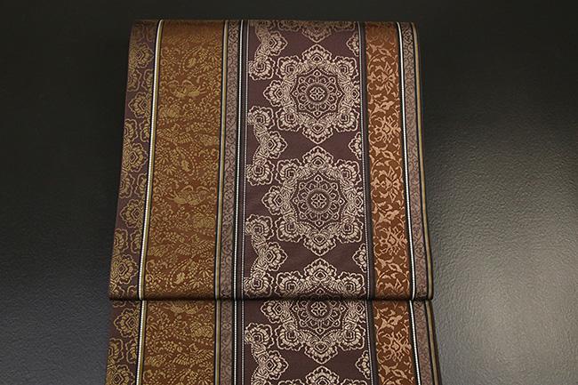 西村織物 博多織 至宝間道 吉祥正倉院文様 本袋帯 正絹 茶 お仕立て付き