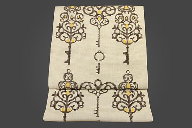 いまのいろ skala 正絹八寸帯 魔法の鍵 ベージュ×茶×黄 かがり仕立付き