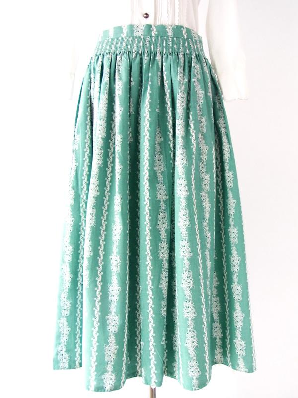 ヨーロッパ古着 フランス買付け グリーン×白小花柄×山道テープ おとなかわいい ヴィンテージ チロル スカート